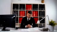 Portrait of young happy businessman in office video