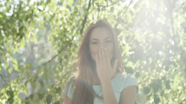 Portrait of young happy woman in park video