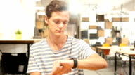 Portrait of Young Man Using smartwatch, video