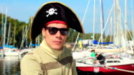 Portrait of young man wearing pirate hat, yachting, sailing video