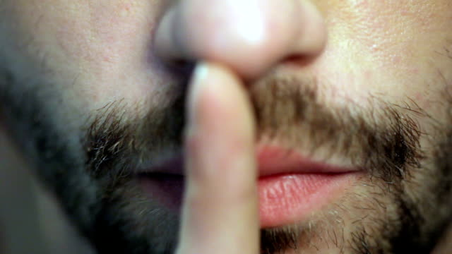 Portrait Of Young Man With Finger On His Lips video
