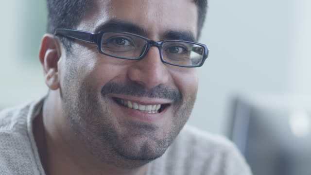 Portrait of Young Smiling Man in Glasses video