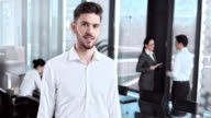 SLO MO Portrait of young team member in conference room video