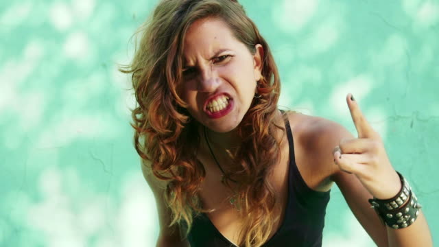 Portrait of young teen rocker singing and shouting video