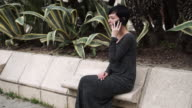Portrait young beautiful businesswoman using application on the mobile phone video