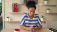 Portrait young mulatto woman texting message on sell video