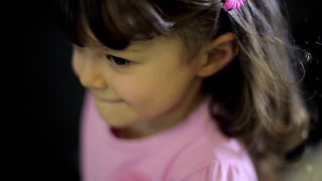 Portraits of children at store. Female child smiles. video