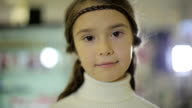 Portraits of children, female child doing facial expressions and smiling video