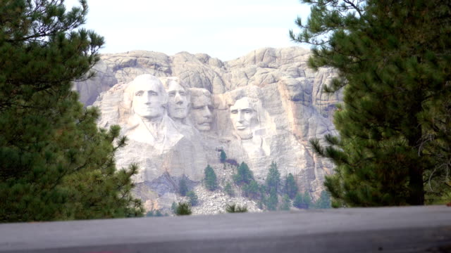 CLOSE UP: Portraits of famous Presidents carved into Mount Rushmore in USA video
