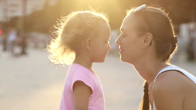 Portraits of mother with daughter hugging and moving nose to nose. video