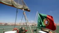 Portuguese flag on a ship on the city background Lisbon Portugal video