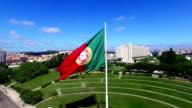 Portuguese Waving Flag in Eduardo VII Park in Lisbon, Portugal aerial view video