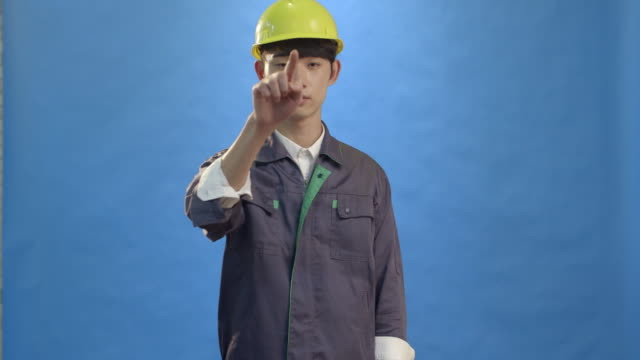 pose and gesture of young man technician 4k video