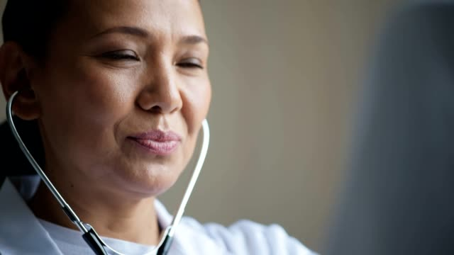 Positive female doctor using the stethoscope video