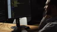 Positive freelance programmer talking on smart phone video