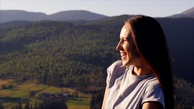 Positive woman enjoying summer vacation at sunset video