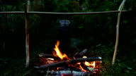 Pot of porridge on the campfire video