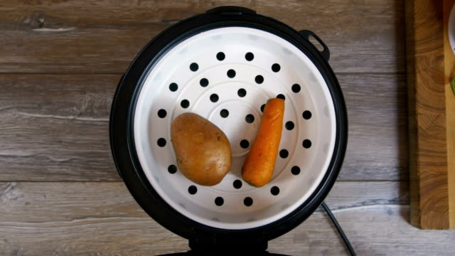 Potato and carrot laid out on a plate from multicooker video