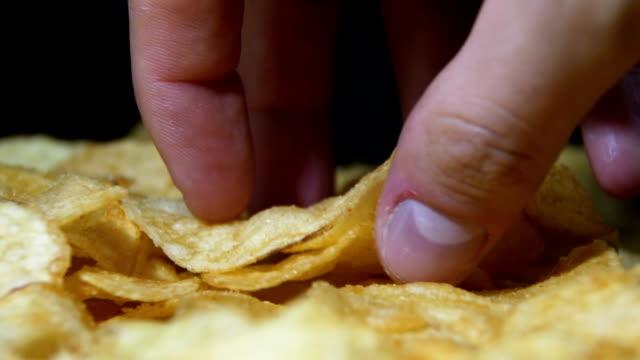 Potato Chips Rotating On Black Background video