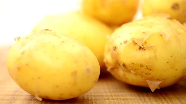 Potato on a board. video