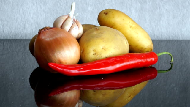 Potatoes, Garlic, Onion and red Chili Pepper zoom out video