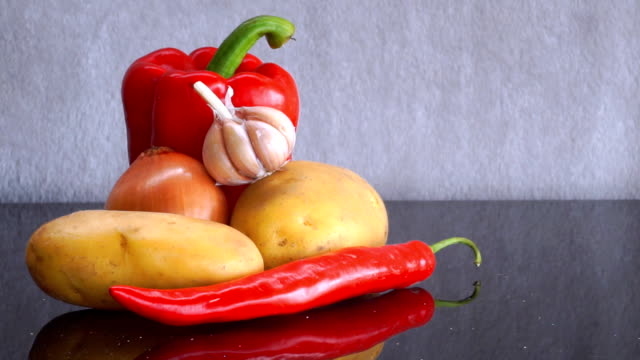 Potatoes, Garlic, Onion, red Bell Pepper and red Chili Pepper zoom in video