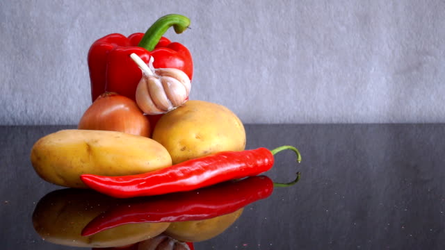 Potatoes, Garlic, Onion, red Bell Pepper and red Chili Pepper zoom out video