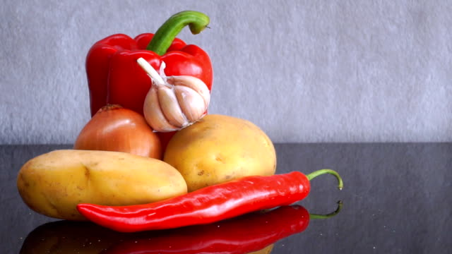 Potatoes, Garlic, Onion, red Pepper and red Chili Pepper zoom out video