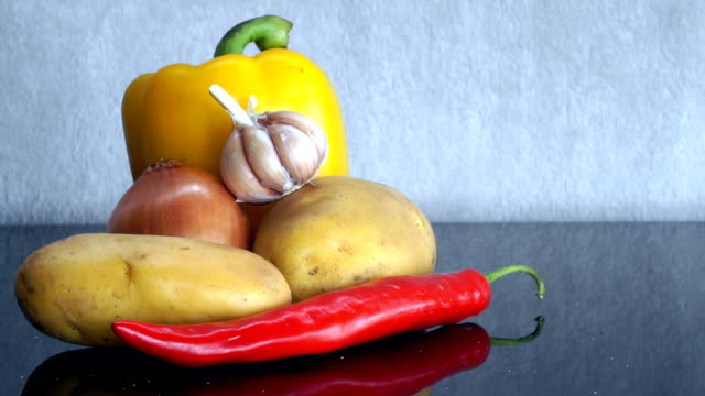 Potatoes, Garlic, Onion, yellow pepper and red Chili Pepper zoom in video