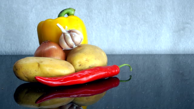 Potatoes, Garlic, Onion, yellow pepper and red Chili Pepper zoom out video