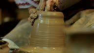 Potter Creates the Product on a Potter's Wheel. Artist Operate Hands. video