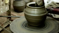 Potter Making a Pot on Spinning Wheel video
