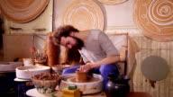 Potter making clay jug video