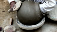 Potter Shaping a Pot at his Home video