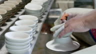 Potter works in workshop video