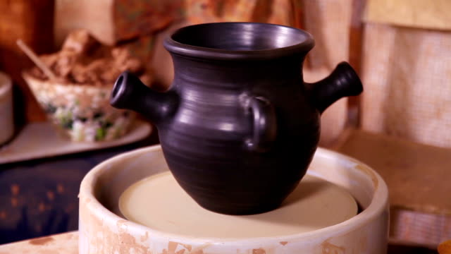Potter's pot rotating on a spinning wheel video