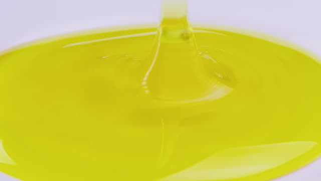 Pour fresh pure honey into a plate. Healthy eating and healthy foods video