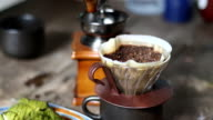 Pour hot water through coffee filters. video