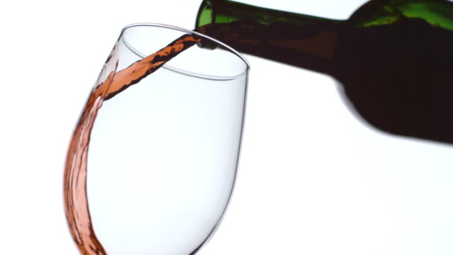 Pouring a glass of red wine in slow motion video