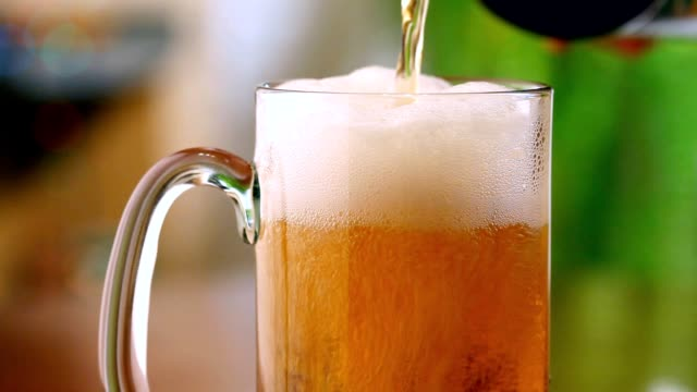 Pouring beer into mug video