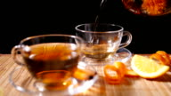 Pouring Blooming Tea with Cinnamon and Orange 2 4K video
