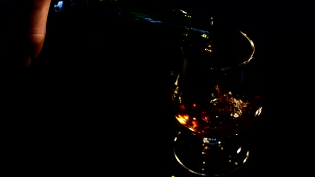 pouring brandy in glass video