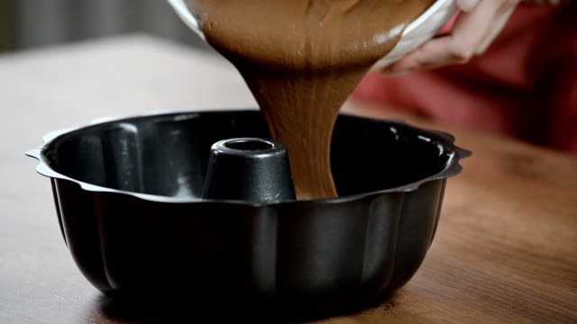 Pouring cake mixture into tin. Making pastry dough. video