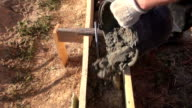 Pouring cement from the bucket video