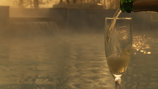 HD SLOW MOTION: Pouring Champagne By The Pool video