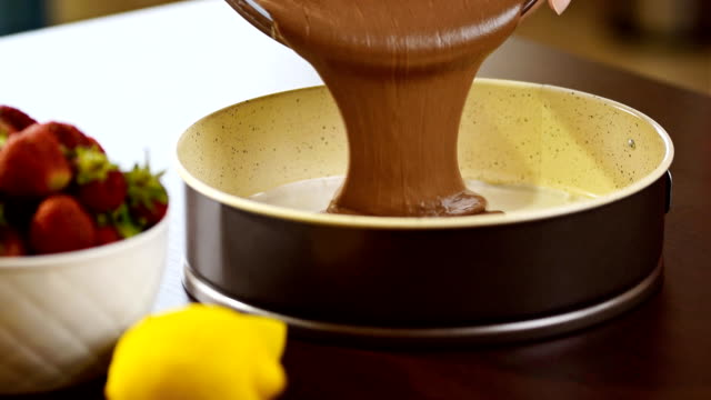 Pouring chocolate cake mixture into tin. Making pastry dough. video