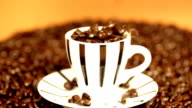 Pouring coffee beans into a cup. video