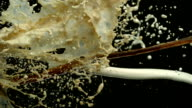 Pouring coffee & milk and making splashes, Slow Motion video