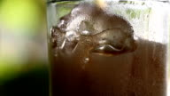 Pouring cola into glass video