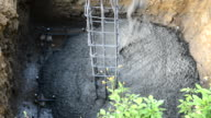 Pouring concrete into reinforcing steel video